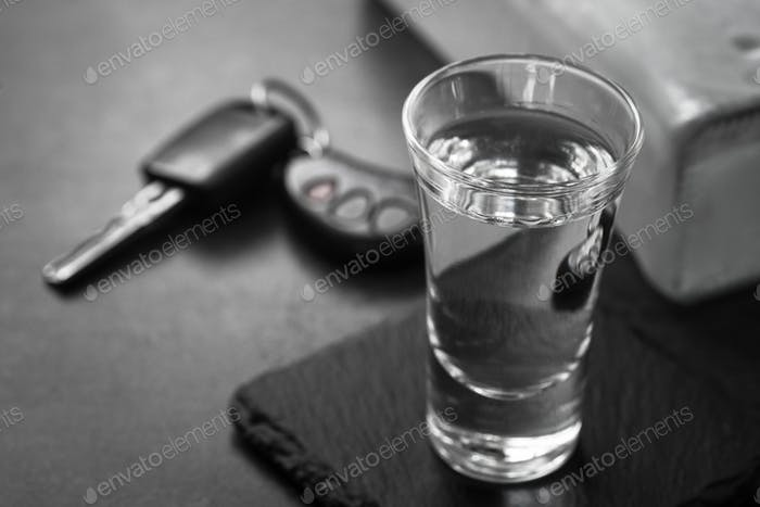 Vodka shot drink and car key.