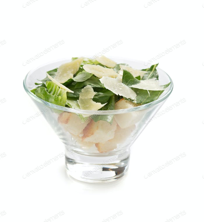 caesar salad in  bowl on white background