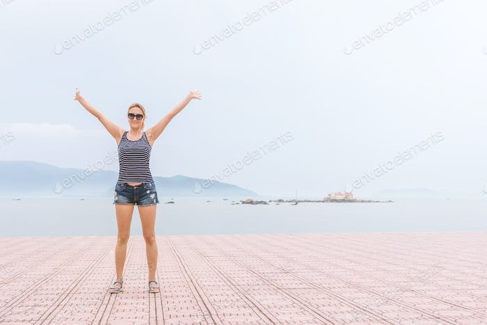 The young girl on sea background