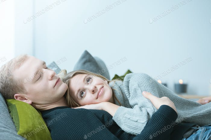 Woman lying on man's chest