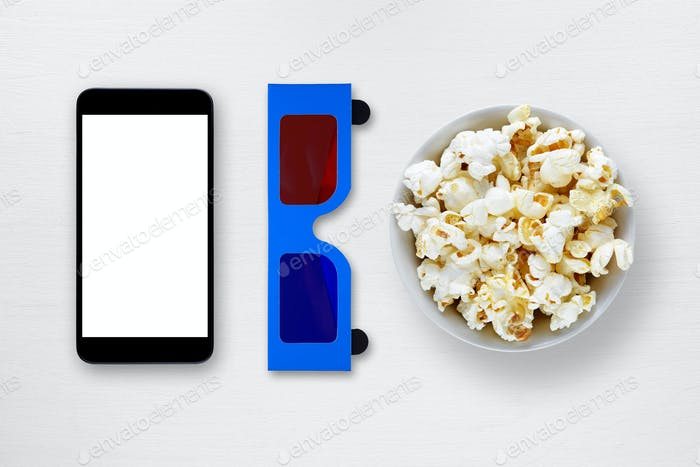 Smartphone, 3d anaglyph glasses and popcorn in bowl on table