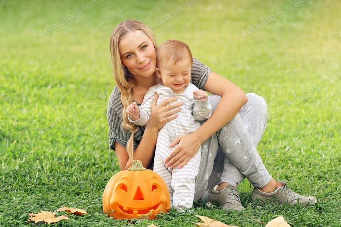 Happy mother with baby outdoors