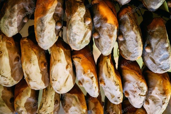 Hanging Italian Dry-cured Ham Prosciutto In Shop. Italian Cuisin
