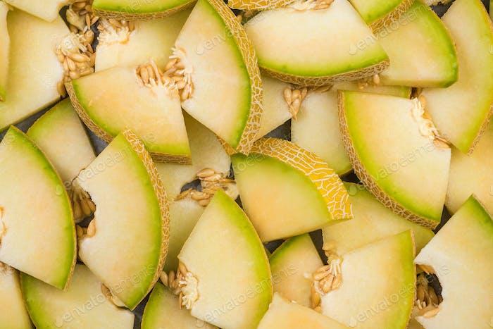 Honeydew melon slices, full frame food background