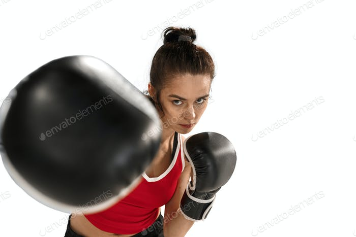 Fit beautiful woman with the boxing gloves isolated on white background