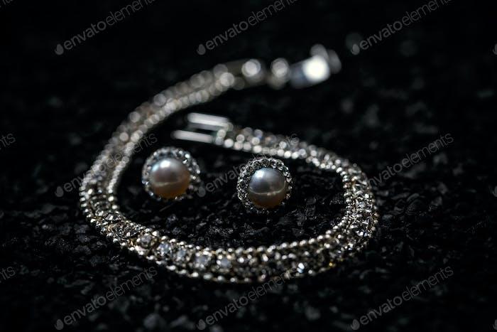 Women necklace, bracelet and earrings