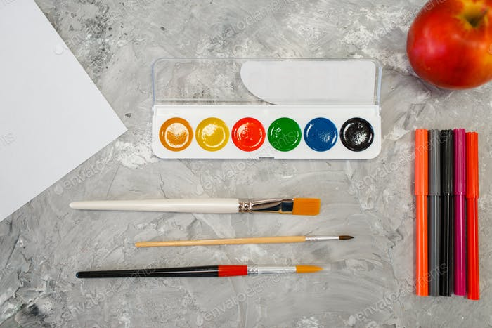 Paints brushes and markers in stationery store