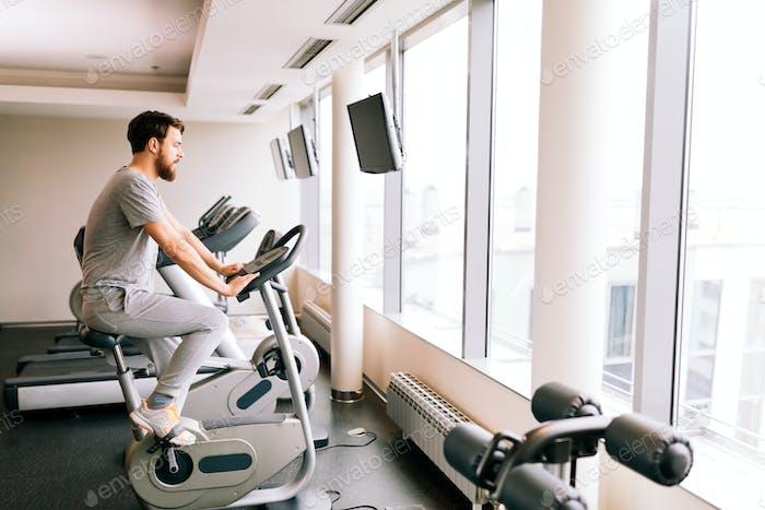 Man cardio training on a bicycle