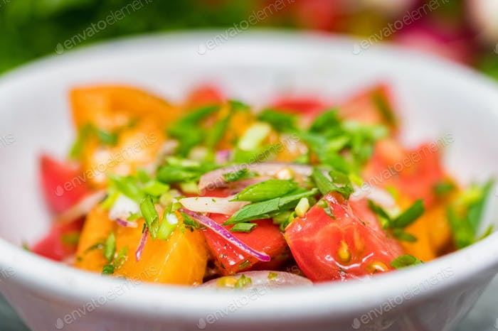 Fresh rustic vegetable salad on rustic background