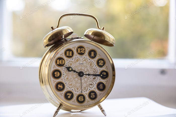 Alarm clock, morning time, blur glass window background
