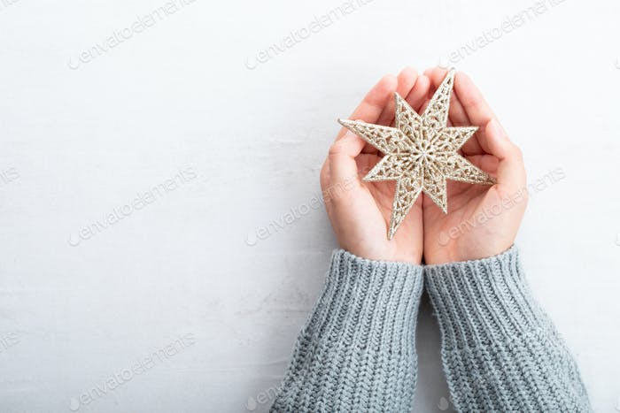 Vintage Christmas background with Christmas decoration in women hand.