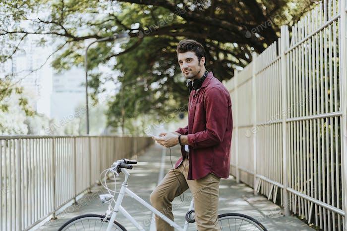 Urban cyclist listening to music
