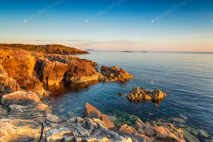 Golden light on the rugged clifftops at Huisinis