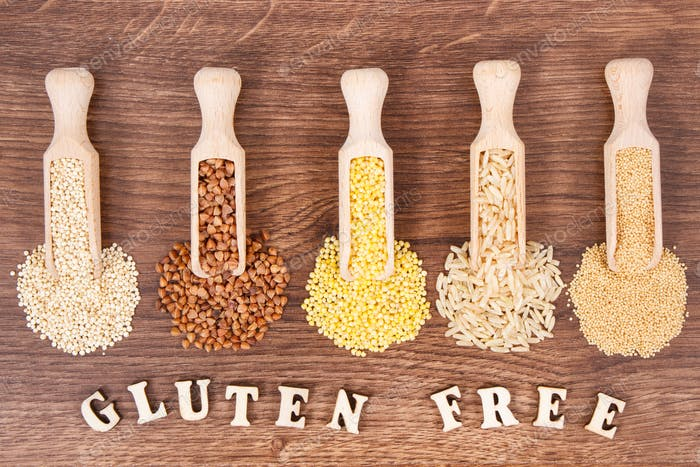 Various groats, brown rice, amaranth and quinoa seeds on board, healthy and gluten free food