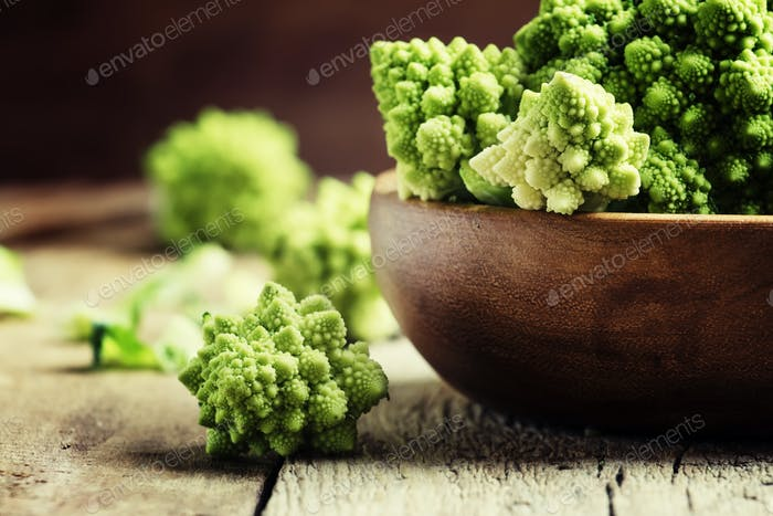 Green romanesco cauliflower in a wooden bowl