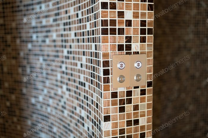 Modern steam bath with mosaic tiles