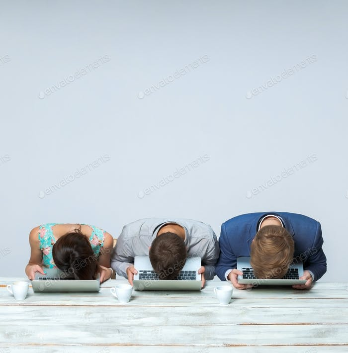 Business team working together at office and sleeping on gray background