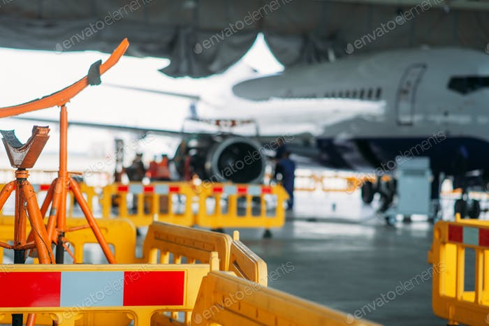 Aircraft engine maintenance in hangar, repairing