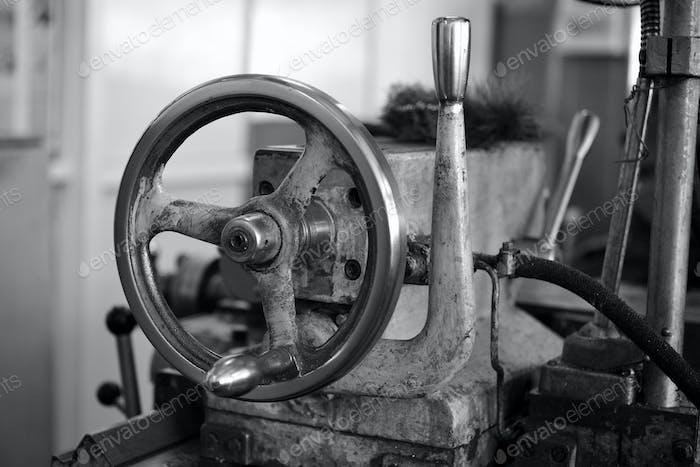 Wheel of lathe. Black and white image