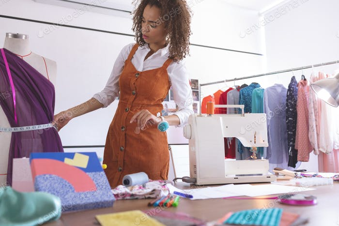 Front view of young Mixed-race female fashion designer working in design studio