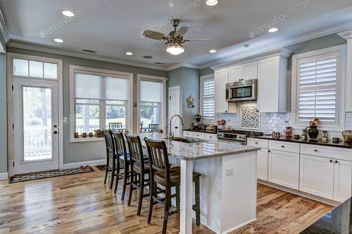 Beautiful kitchen interior with white cabinets.