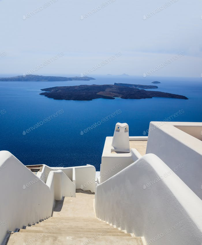 Santorini, Greece. White architecture against blue sea and sky background.