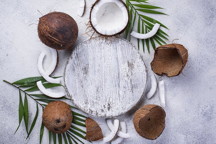 Sliced coconut and palm leaves