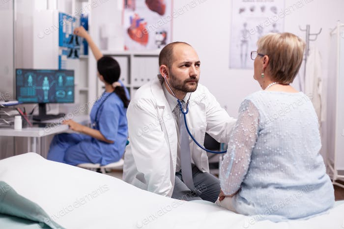 Healthcare specialist using stethoscope in private clinic