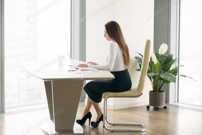 Young woman working at the office desk