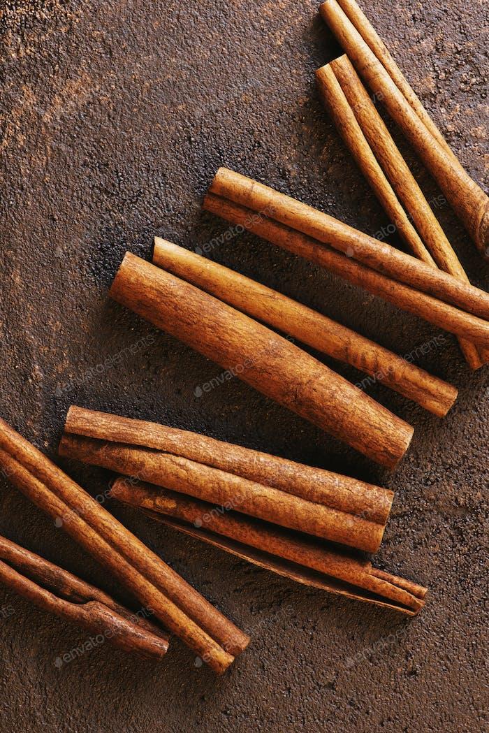 Cinnamon Sticks on the Brown Textured Table