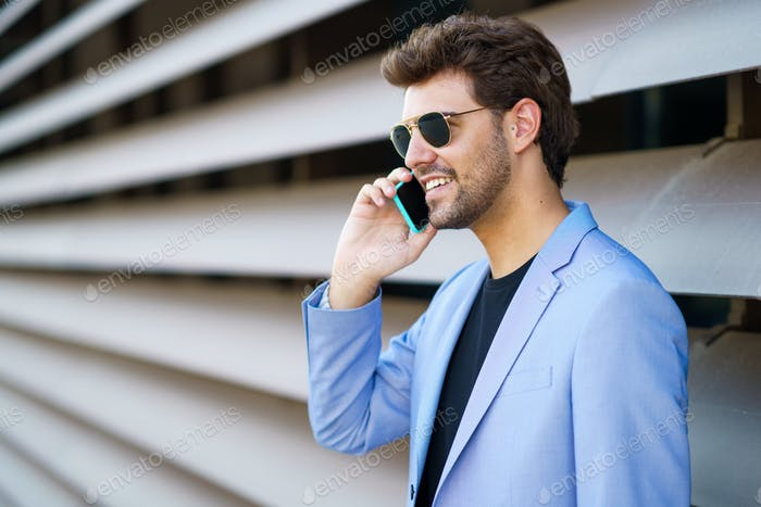Man talking to his smartphone with a happy expression