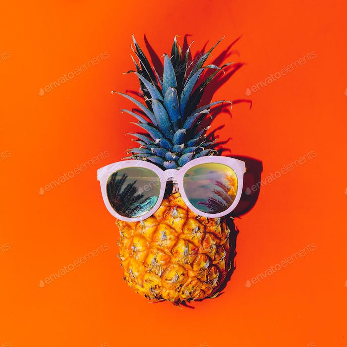 Tropical style. Pineapple in sunglasses. Summer Cocktail