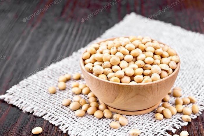 Soybeans in wooden bowl on board