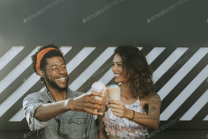 Cheerful couple enjoying ice cream