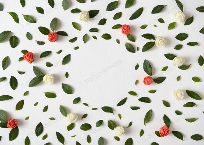 Creative layout made with green leaves and colorful flowers on bright background. Minimal nature