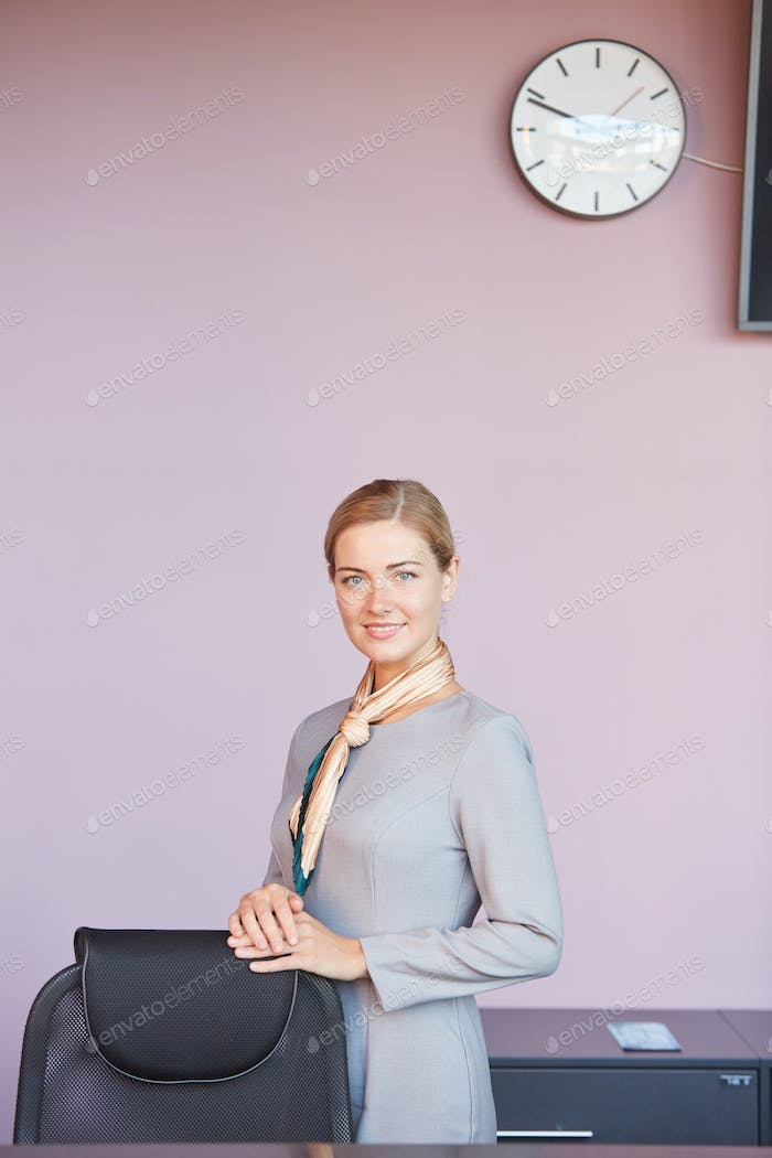 Elegant Businesswoman Posing against pink Wall in Office