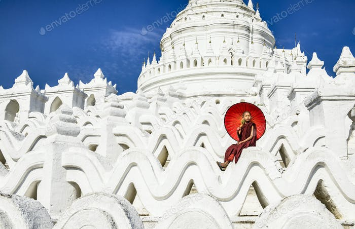 55006,Asian woman sitting on temple walls, Mingun, Saigang, Myanmar
