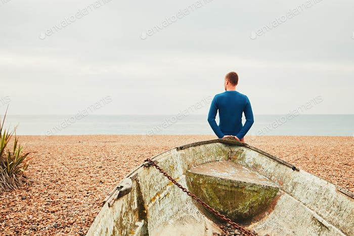 Alone and pensive man on the beach