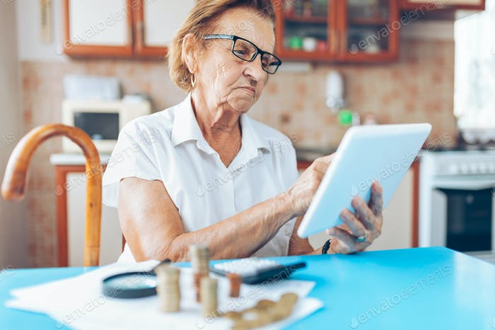 Senior woman checking her finances and invenstments