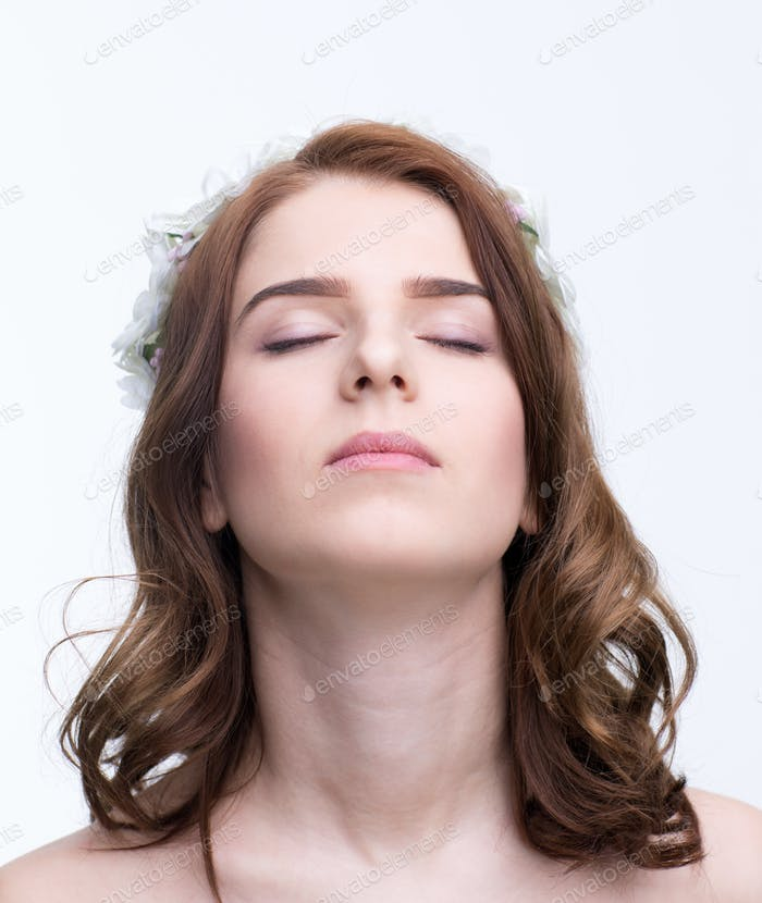Portrait of a beautiful young woman with closed eyes