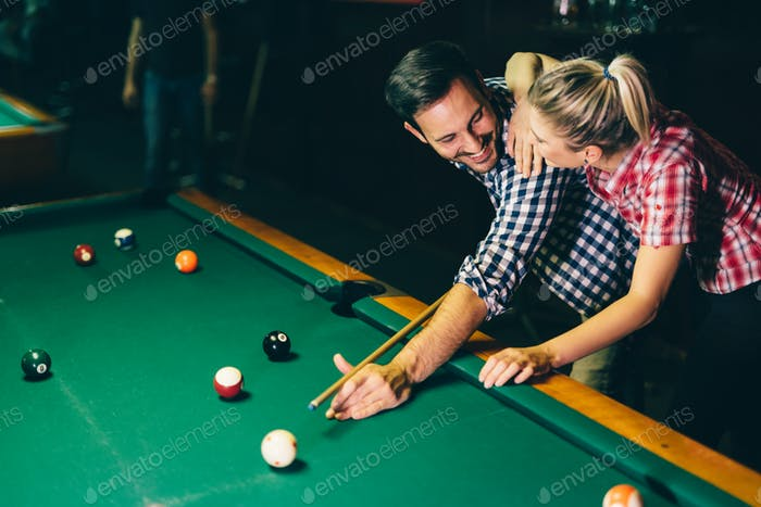 Thumbnail for Young couple playing snooker together in bar