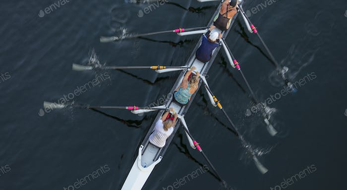Female crew racers rowing, high angle view, Lake Union, Seattle, Washington, USA.