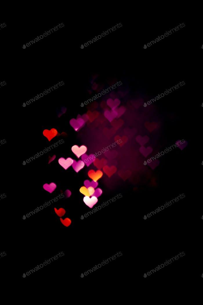Abstraktes Licht, Bokeh Muster in Herzform