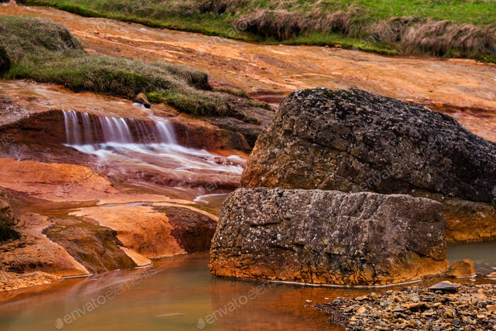 Stream And Rost Colored Rocks, Island