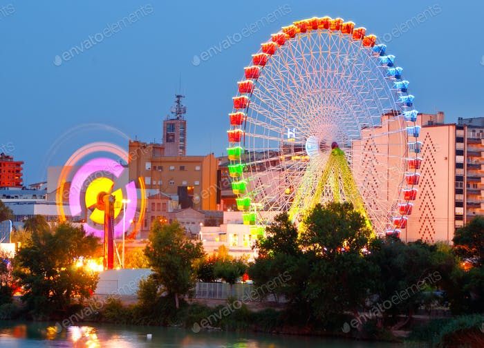 Fair Ferris wheel adorned with lights at night