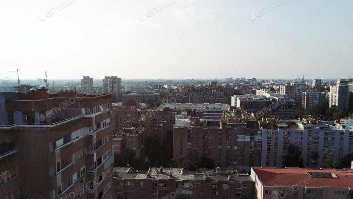 Crowded cityscape with buildings, apartment in background