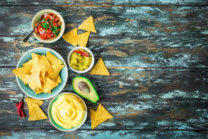 Tortilla chips and assorted dips