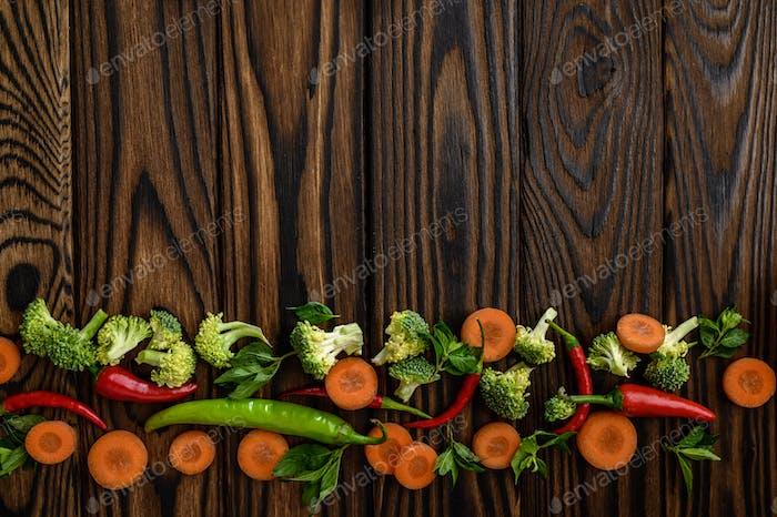 Fresh vegetable ornament on wooden background