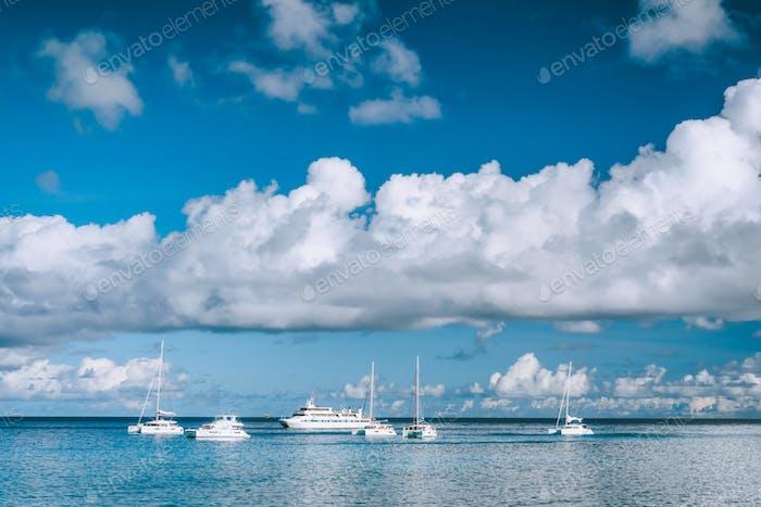 Boats anchored in port of La Digue island, Seychelles