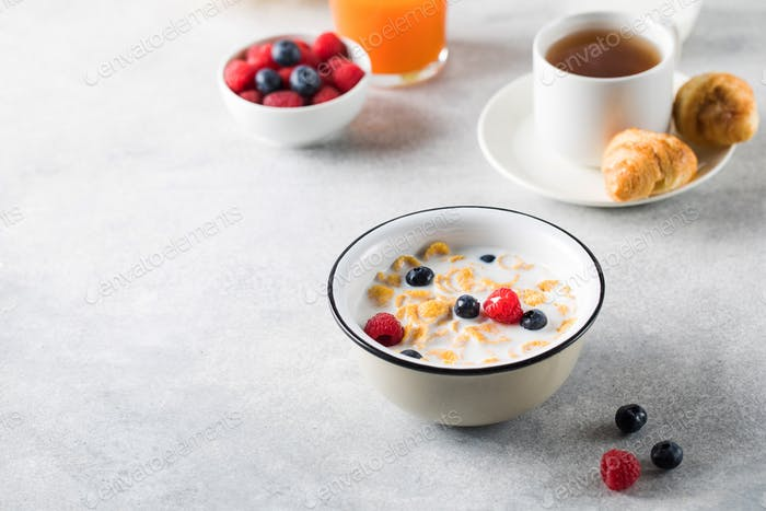 Cornflakes with berries and milk. Dry breakfast.